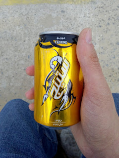 A guy holding a can of energy drink